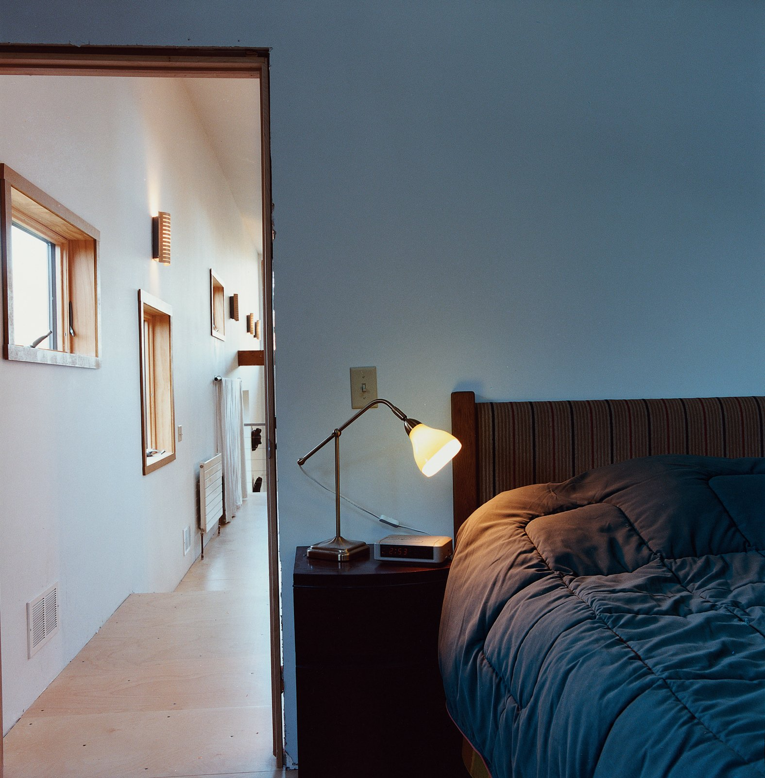 A hallway lined with windows provides a distinctive gateway to the bedroom.  Photo 8 of 12 in Labor of Loved Ones