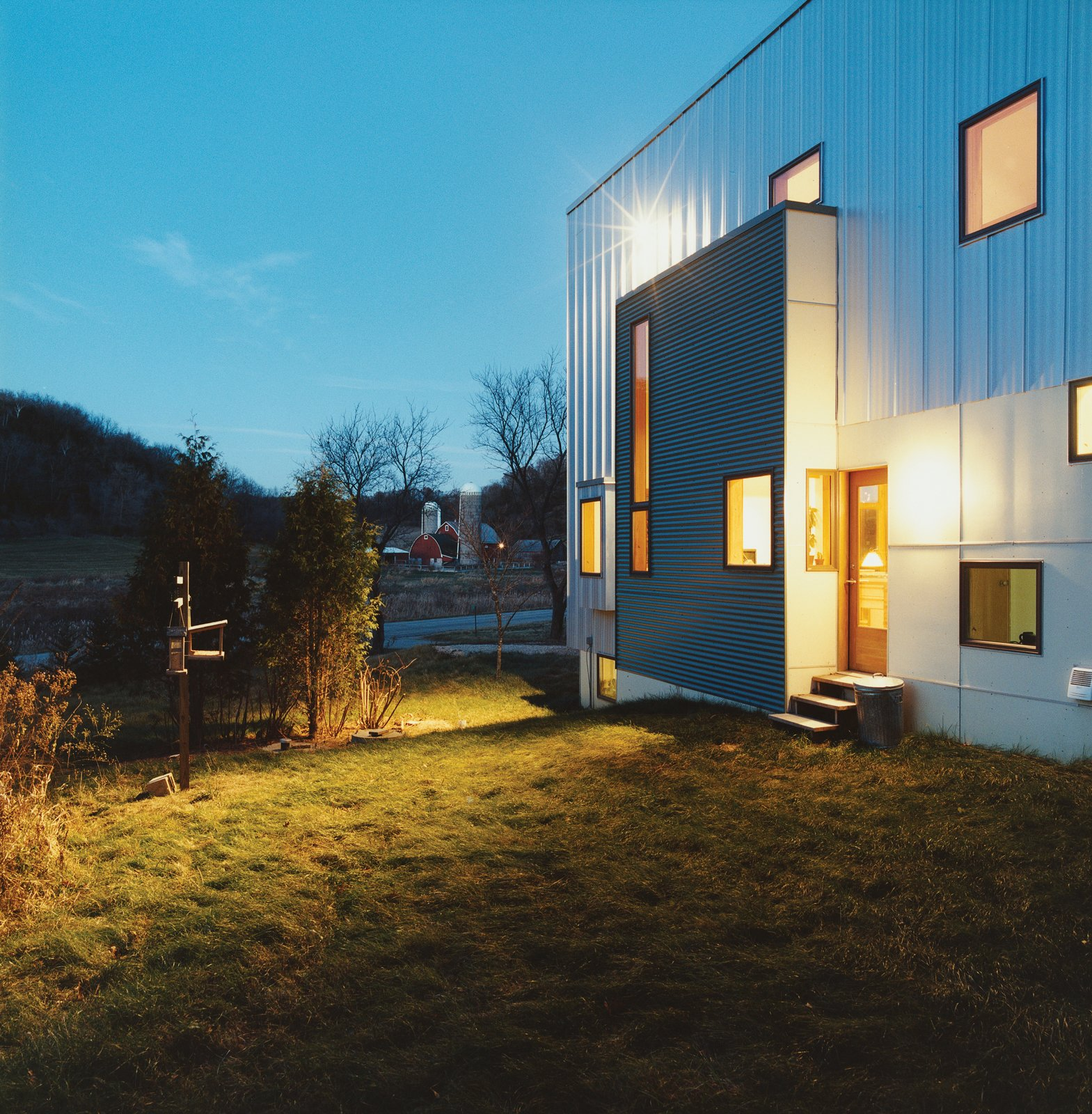 The rear of the house, which could have been treated as an afterthought given the project's minimal budget, is instead a lively essay in form and color.  Photo 12 of 12 in Labor of Loved Ones