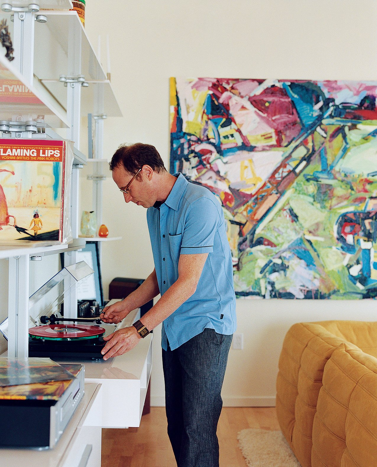 Randy Rapaport can't get enough of his favorite band, the Flaming Lips, and happily whiles away the hours spinning their records in his 1,000-square-foot loft. On the wall is a painting by Timothy Scott Dalbow that Rapaport picked up from the nearby New American Art Union Gallery.  Photo 2 of 10 in Community Building