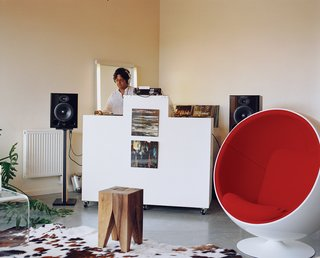 Attorney by day, DJ by night, Sanjiv Kripalani's design inspiration for his Belmont loft was the futuristic vision of director Stanley Kubrick. The Ball chair by Eero Aarnio is manufactured by Adelta.