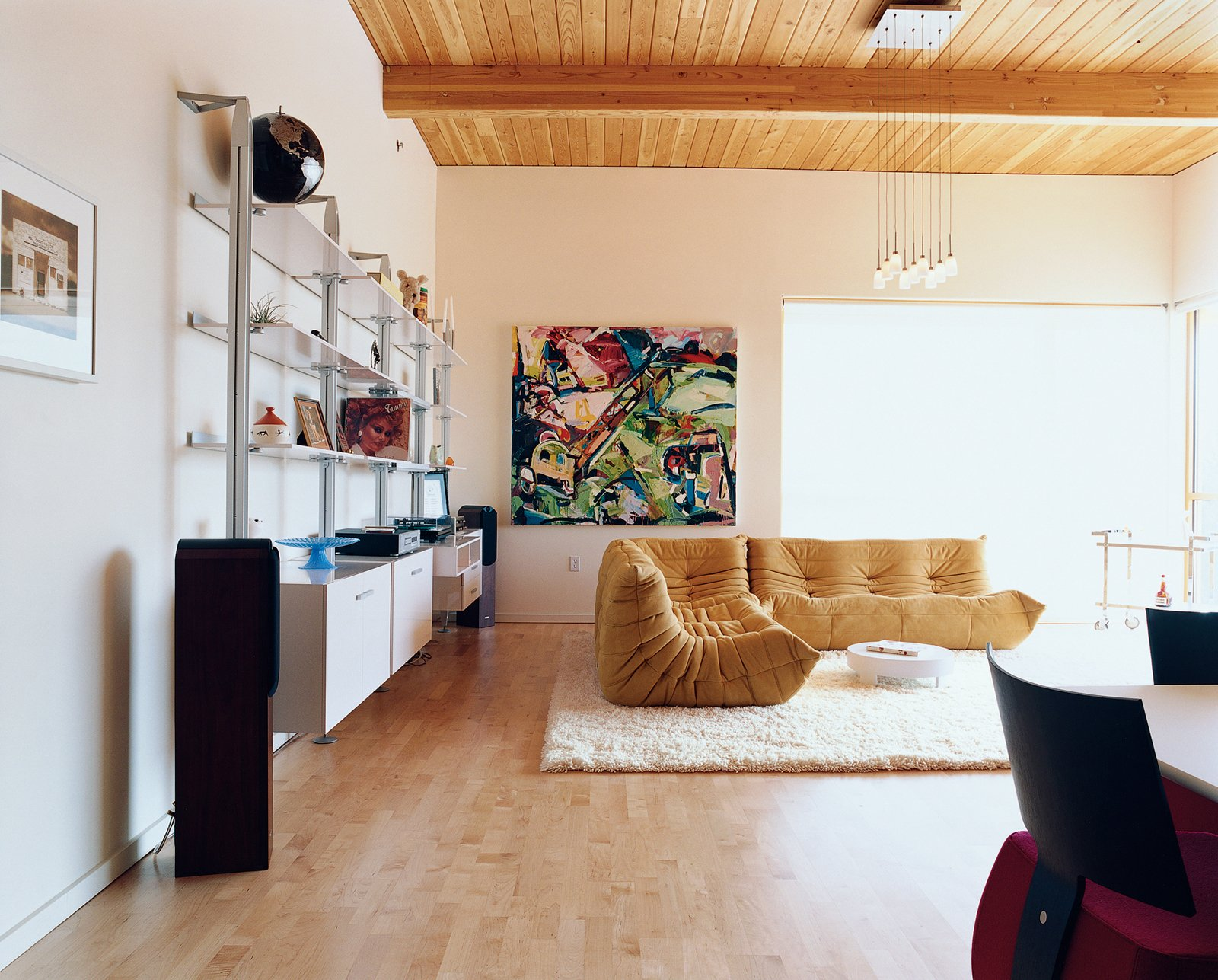 Rapaport is a confirmed Ligne Roset fanatic—his living room may as well be a showroom for the French manufacturer. The centerpiece is a classic Togo sofa designed by Michel Ducaroy; the wall system was designed by Pagnon and Pelhaitre.  Photo 9 of 10 in Community Building