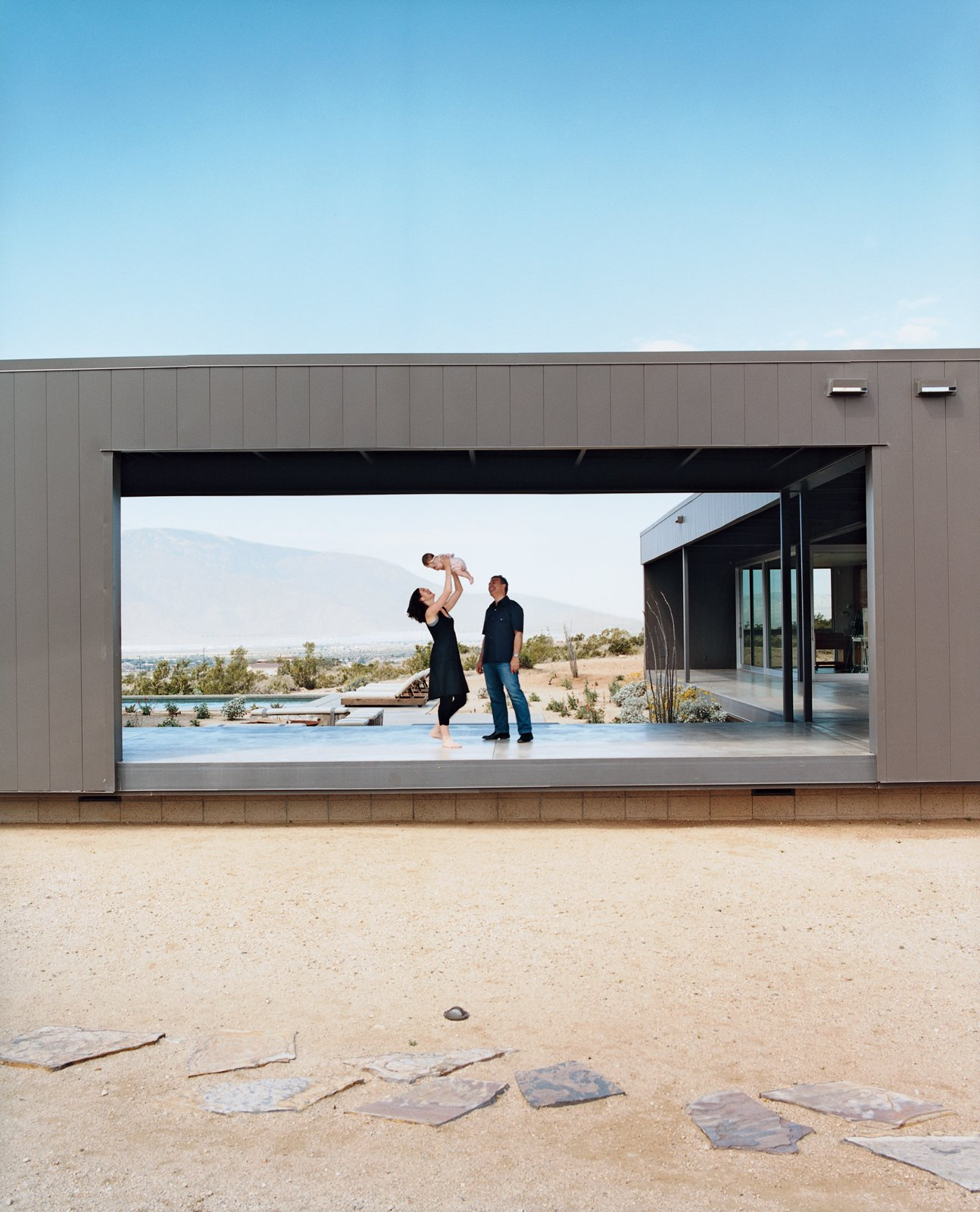 Exterior, House Building Type, Metal Siding Material, and Flat RoofLine Marmol and Becket with their daughter, Emilia. The intersecting modules were designed to frame a range of spectacular desert vistas.  Photos from Desert Utopia