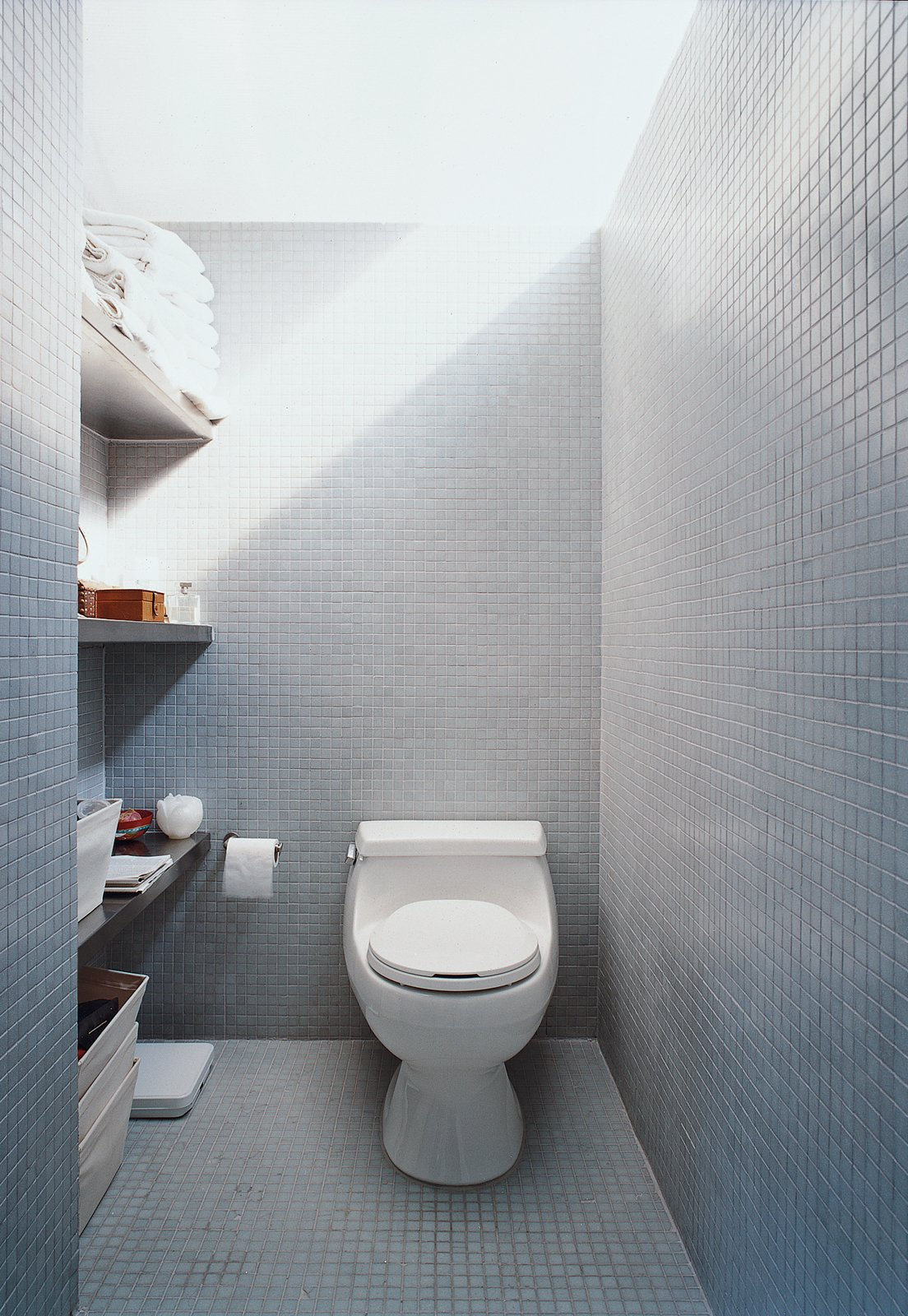 Bath, Ceramic Tile, and One Piece The LV prototype's bathroom shows how buyers can vary finish levels according to budget.  Best Bath Ceramic Tile One Piece Photos from All You Need Is LV