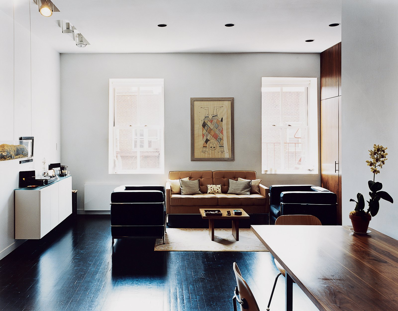 """The floors were sanded and painted a deep matte black. The black makes the apartment look much bigger than it is,"""" explains Barmon.  Photo 4 of 4 in Village Green"""