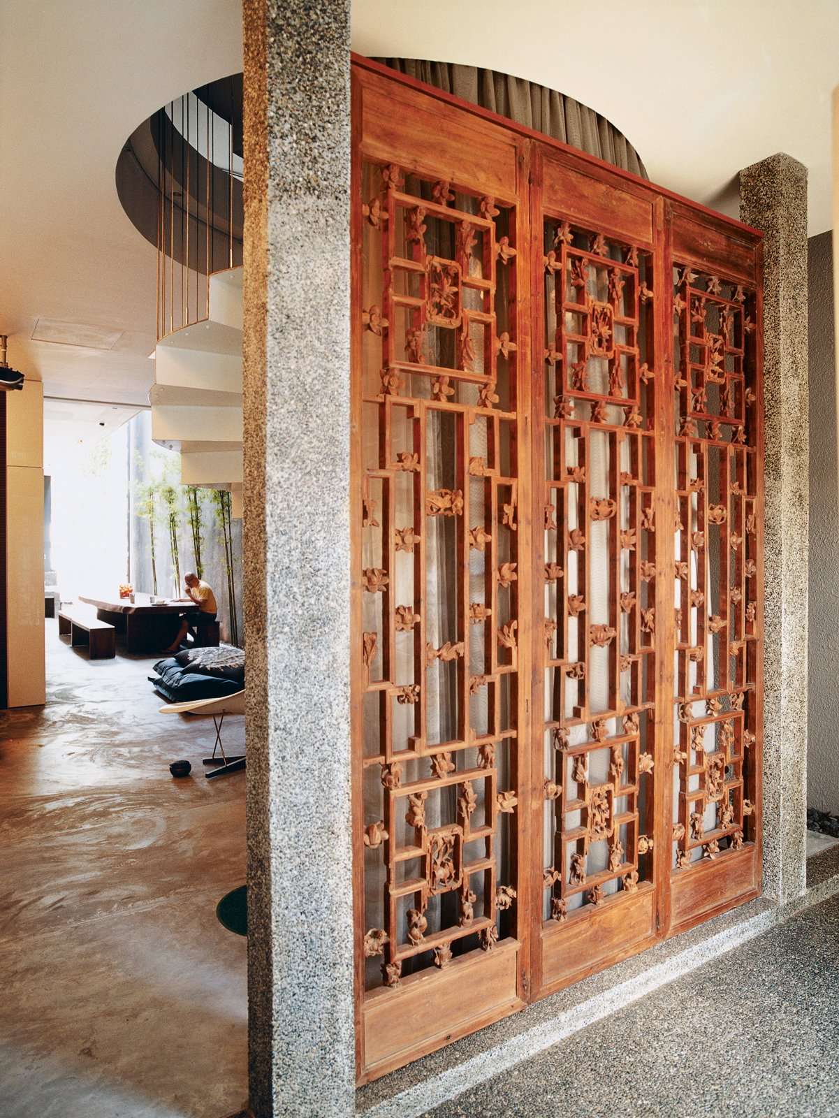 Doors, Wood, Swing Door Type, and Interior Once inside, visitors are greeted by three ten-foot-tall hand-carved antique panel doors.  Photo 2 of 9 in Straight and Narrow