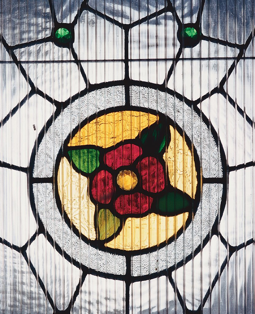 Although his designer friends give him a hard time about it, White decided to keep the original home's stained glass by the entry.  Photo 7 of 9 in Cooler Ranch