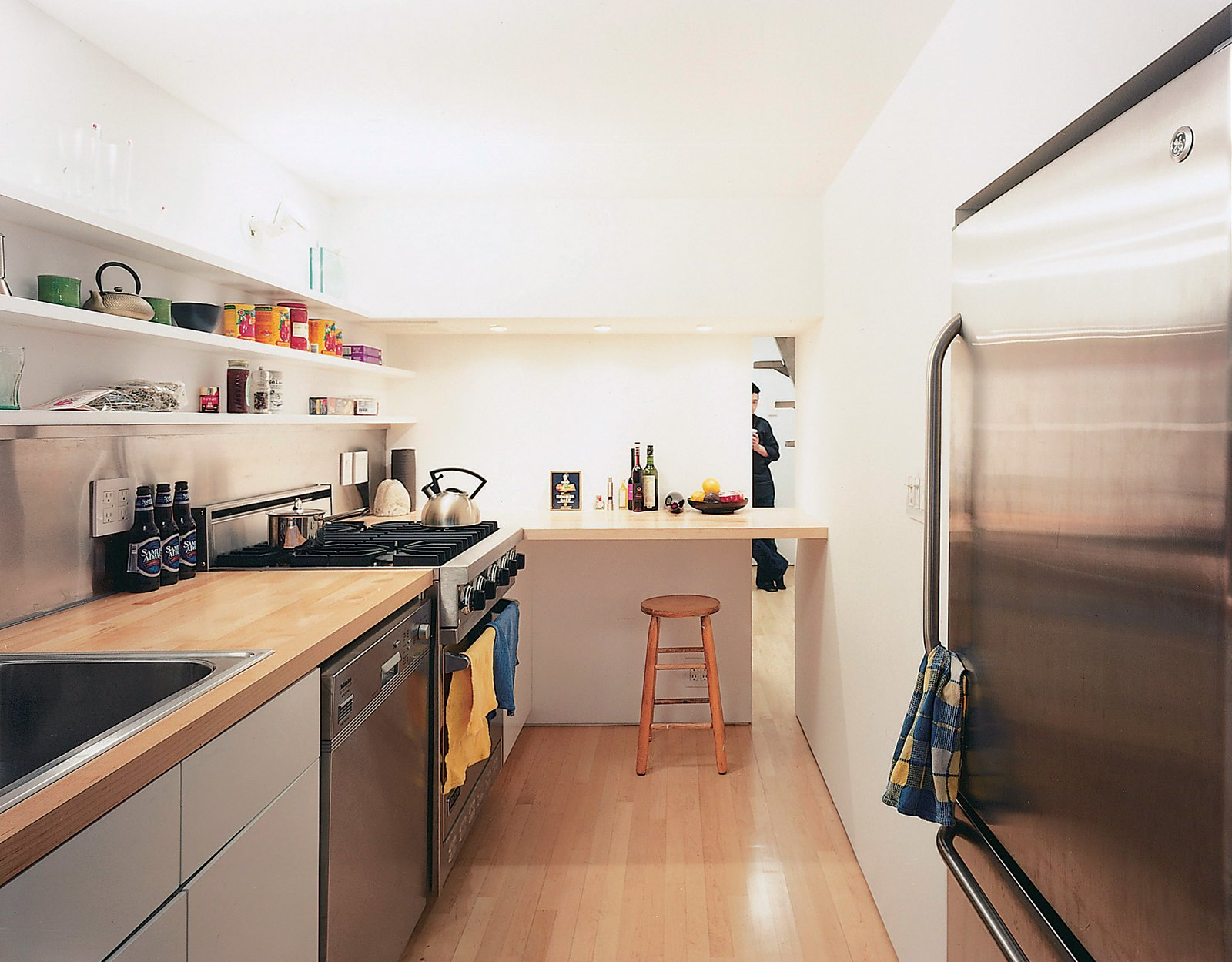 """""""The dimensions are so tight, the height especially,"""" says the architect. """"By densifying the core—the bathroom, kitchen, and bedroom—the rest became much more spacious than it used to be.""""  Photo 5 of 7 in Big City, Little Loft"""