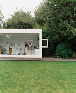 Phillips designed Judith a stark white, glass-fronted art studio.
