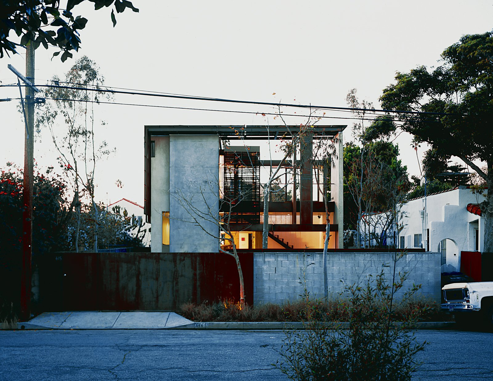 Exterior, House Building Type, and Flat RoofLine Brooks and Scarpa took an unlovable old bungalow that occupied a deep through lot, with streets front and rear, and transformed it into their dream home. The ingenious new solar-framed façade is seen here.  Photo 8 of 8 in Solar Inspiration