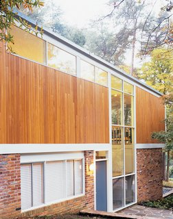 During the 2004 renovation the Wilsons replaced the plywood siding with cedar, and used reclaimed brick to maintain the home's classic appearance.