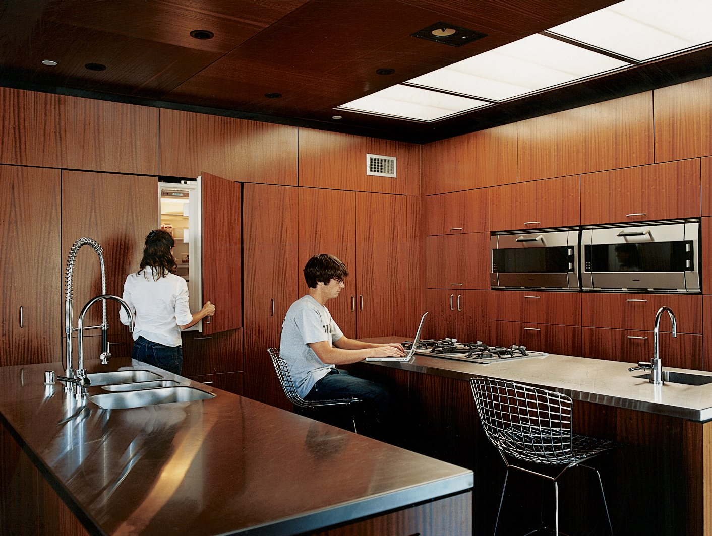 Kitchen, Wood Cabinet, Wall Oven, Metal Counter, and Ceiling Lighting Segal designed the kitchen cabinets. The oven and cooktop are by Gaggenau; the sink is by Franke.  Photo 5 of 10 in The Jonathan