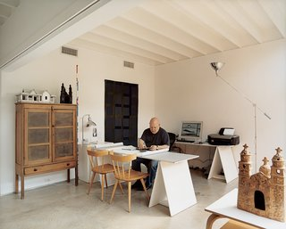 """Baum uses his """"flex room"""" as his architectural office, but in the other three units adjoining his, the same space has been used as an extra bedroom and a TV room."""