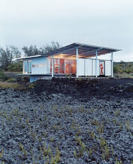 For an escape from bustling San Francisco, architect Craig Steely and his wife Cathy have created a modernist getaway on a lava field next to a black sand beach on Hawaii's Big Island. Fitted with floor-to-ceiling windows that look out over the ocean, the steel-framed home is one of several homes that Steely built on the recently active lava field.