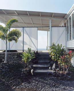 The lava rock used for the steps was cut on a giant saw near Hilo. Craig finished assembling the staircase just in time for Zane's one-year baby luau.