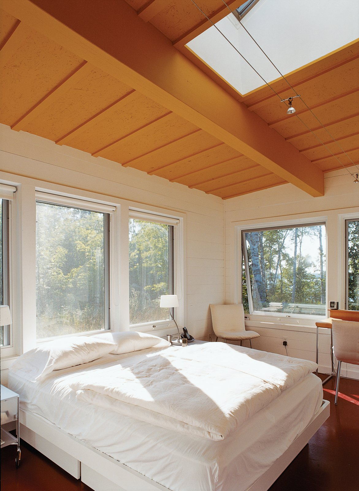 Skylights and huge windows flood the master bedroom—and every room in the house—with sunlight. Bed by Techline; lighting by Tech Lighting.  Photo 10 of 10 in Off the Beaten Path