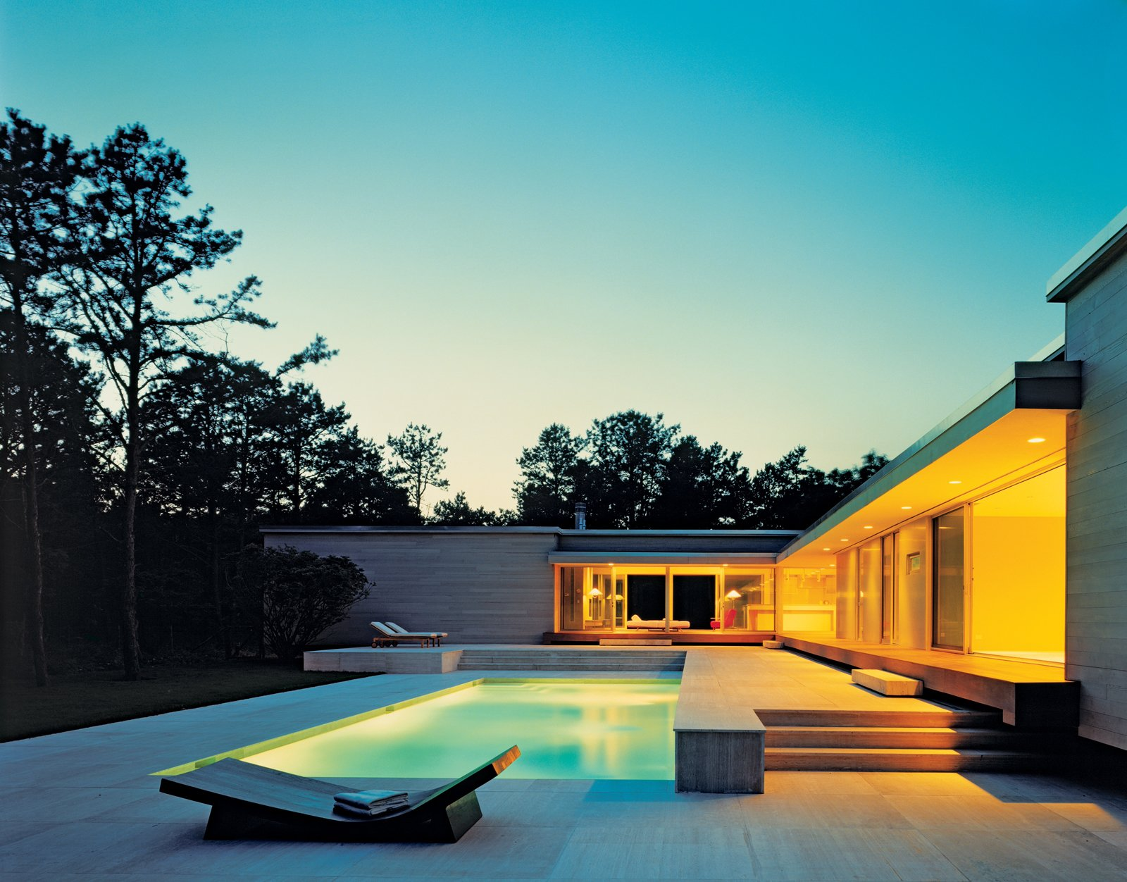 House 43's modernist elevation is both monumental and inviting. These shots show the Hariri design in its spec stage, before the first residents, Heide Banks and Howard Lazar, moved in. Photo: Paul Warchol, Courtesy of HARIRI & HARIRI ARCHITECTURE  Modern Pool Design by Dwell from Seeing What Develops