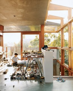 In the new addition to the Hertz/Fong residence, the architect's son Max tinkers with his extensive array of Legos and War Hammer miniatures in the upstairs office/playroom.