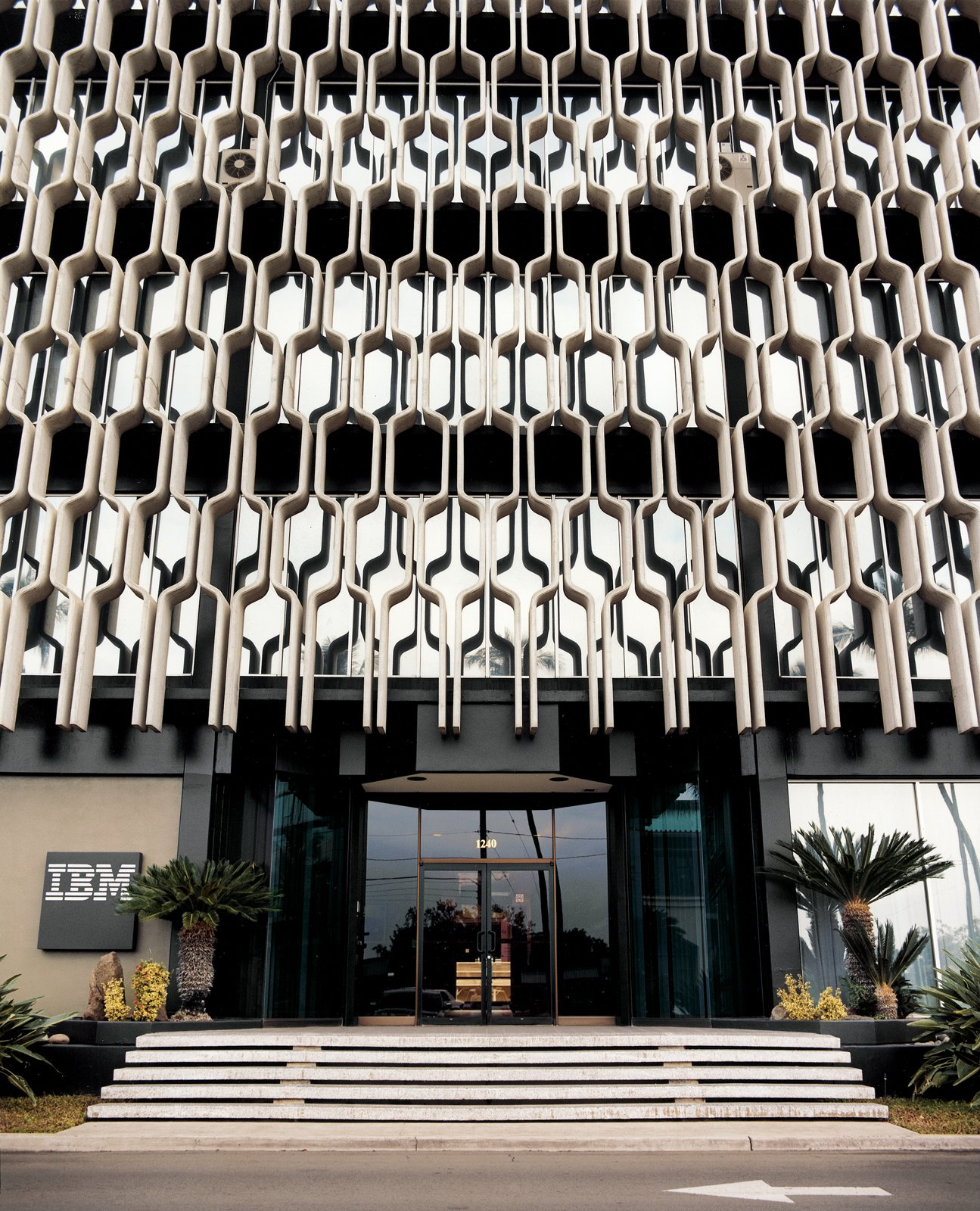 Honolulu IBM BuildingVladimir Ossipoff's iconic IBM Building, with its graphic concrete sunshade cladding, is sited in Honolulu, Hawaii.  Reasons to Love Design Made in America by Dwell from Honolulu, Hawaii