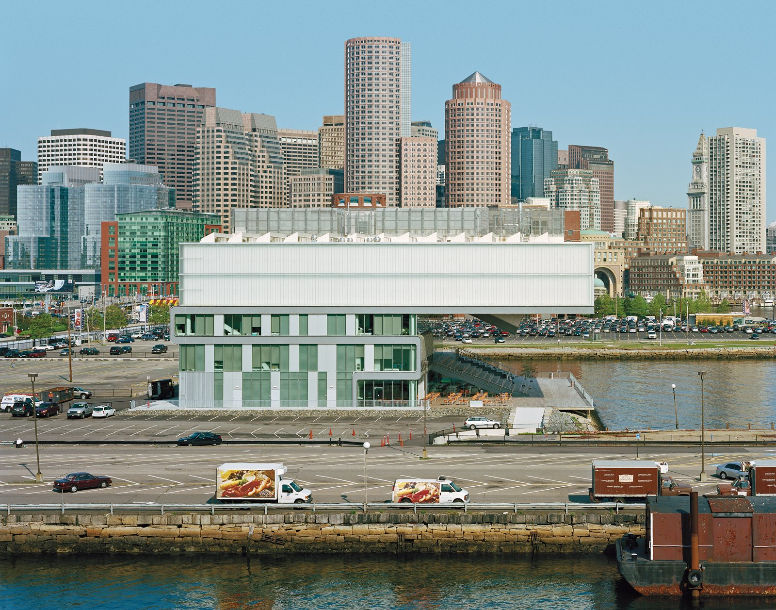 The Institute of Contemporary Art, designed by Diller Scofidio + Renfro, sits harborside, backed by the financial titans of the city skyline. The surrounding parking lots will disappear as the district is developed in the coming years.  Photo 1 of 12 in Boston Pops