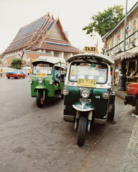 Perhaps the most sweetly named mode of transportation, a group of Tuk Tuks park outside the Grand Palace.
