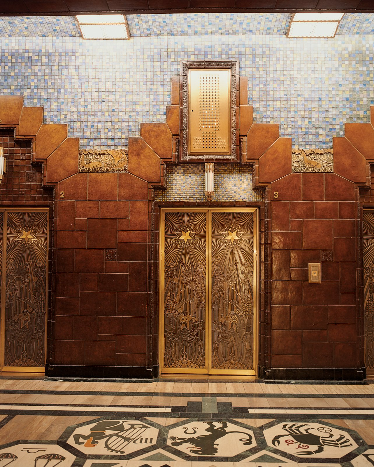 Lavish tile treatment and intricately-etched elevator doors are found inside the Art Deco Marine Building.  Photos from Vancouver is an extroverted city