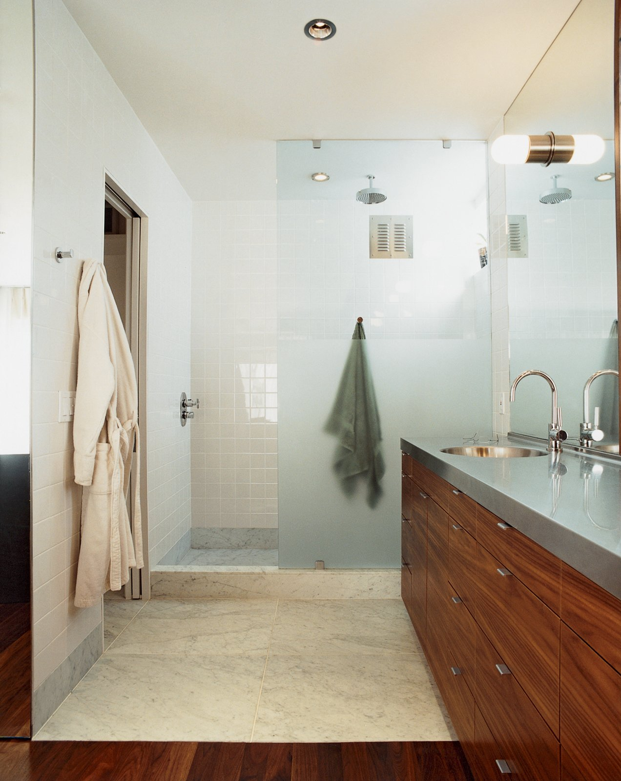 Bath Room, Undermount Sink, Dark Hardwood Floor, and Marble Floor The unifying elements of walnut and steel—with a little marble and concrete thrown in—continue downstairs in the bathroom and bedroom.  Photo 2 of 9 in Standout in a Crowd