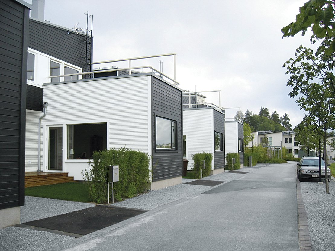 Silverdal Terrace I, Holmberg and Smedshammar's version of prefabricated suburbia, uses black and white to demarcate public and private spaces.  Photo 3 of 8 in The Suburbs Strike Back