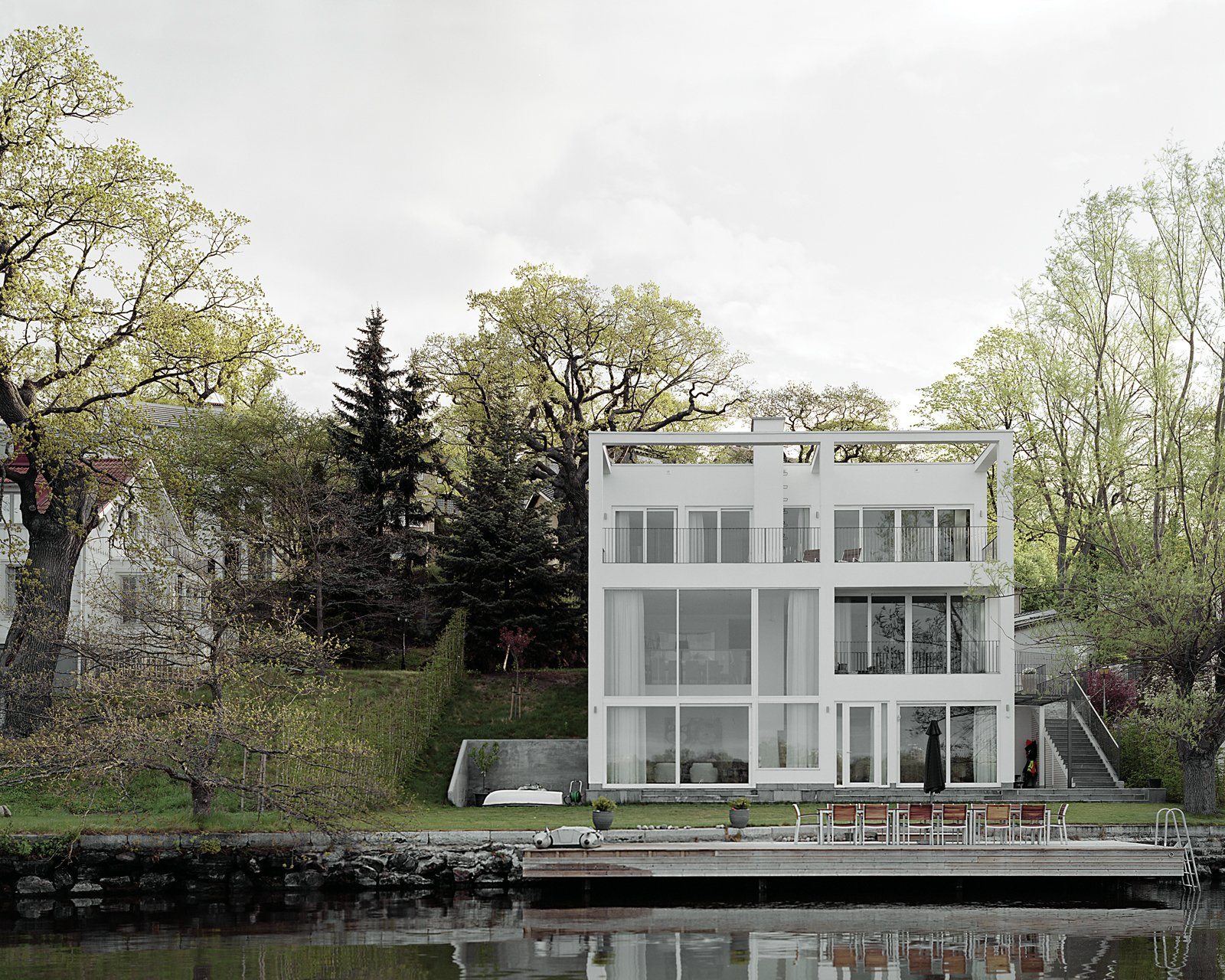 """Villa Oscar is a typical example of a Smedshammar + Holmberg private commission, where a wooden frame is used to """"frame"""" the house in the landscape.  Photo 6 of 8 in The Suburbs Strike Back"""