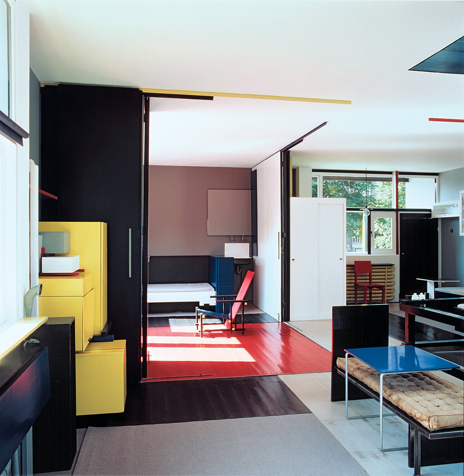 Color featured prominently in the Rietveld Schröder House, although Rietveld later banished it from his work. Mulder's restoration reinstated the yellow stacking cabinet on the left.  Living Rooms by Dwell from Et tu, Bertus?