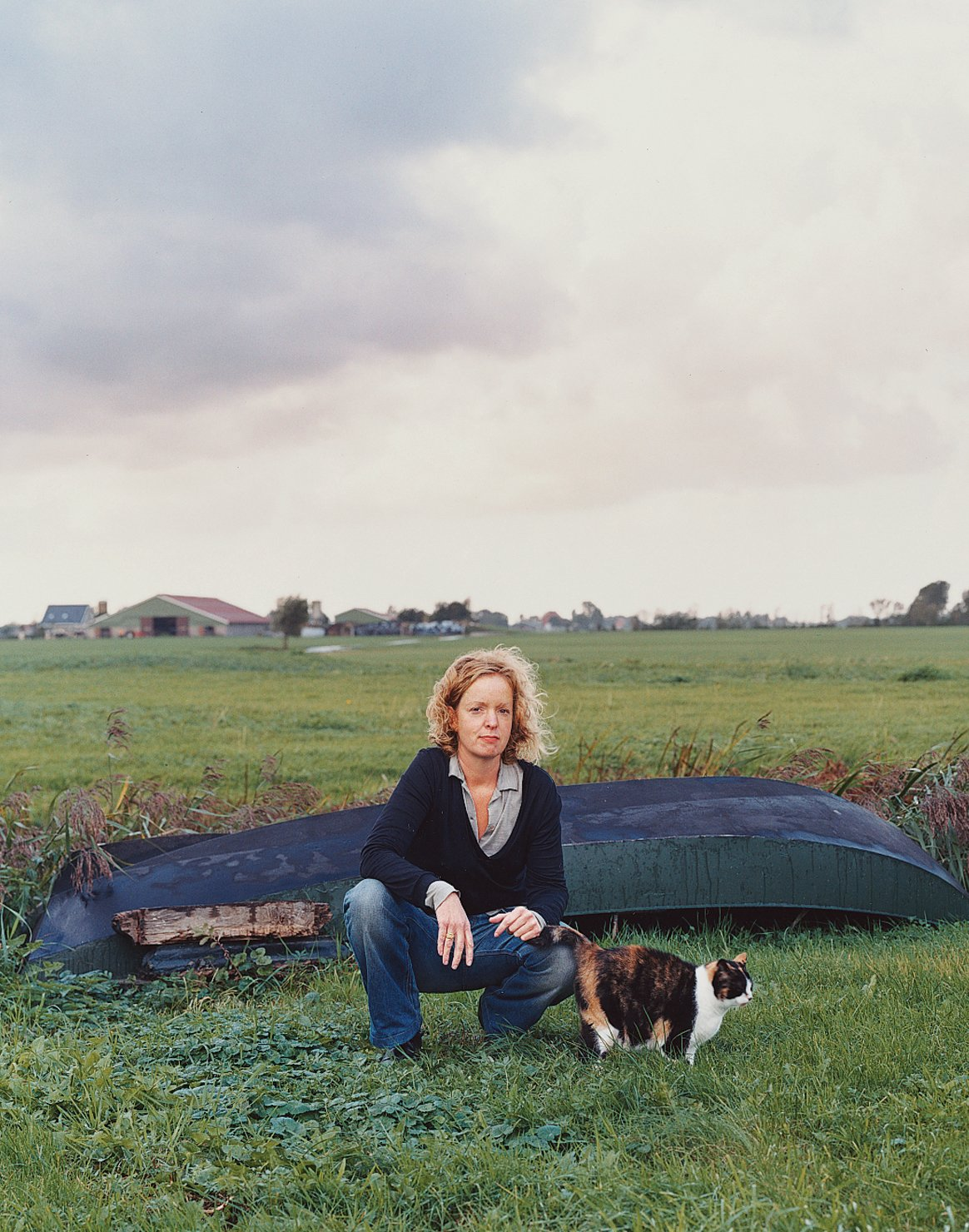 Outdoor Claudy Jongstra kneels with a family cat in the yard behind her office and home, which she shares with her partner, Claudia Busson, and their two sons, Eabal and Jesk. Behind her is a small dinghy that the family uses to navigate the numerous irrigation canals that traverse the farmlands throughout Friesland. Despite its modest scale, Jongstra's studio has worked on major collaborations with Hella Jongerius,Tord Boontje, Steven Holl, andRem Koolhaas, in addition tofashion design for Alexander van Slobbe and costume work for Star Wars: The Phantom Menace.  Dwell's Favorite Photos from Shear Talent