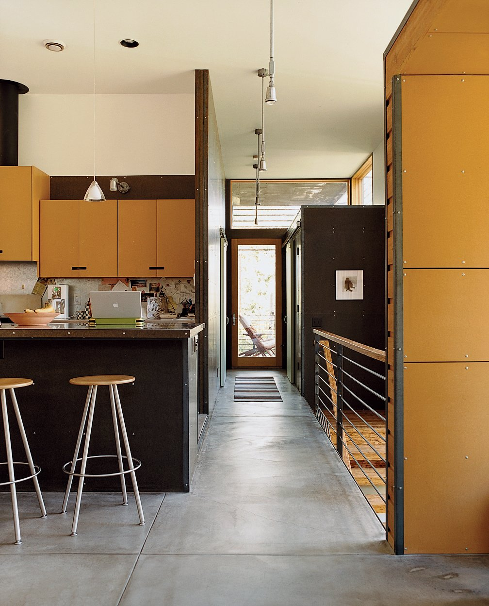 Kitchen, Concrete Floor, and Pendant Lighting Oiled concrete floors inform the interior of the Stanwood residence.  Photo 9 of 10 in Jackson, WY