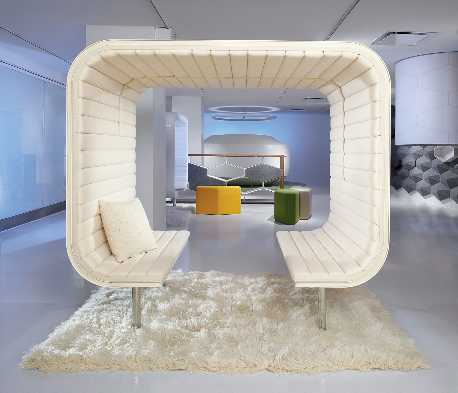 Steelcase's Dyadic Slice is the two-person version of its Digital Yurt concept: a Corian pod that blocks outside noise and gets brighter when sensors detect hot ideas.  Photo 1 of 1 in Steelcase