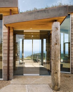 """Native grasses, large wood timbers, and plentiful amounts of stone help maintain the sense of """"living close to nature"""" that the Treadwells desired."""