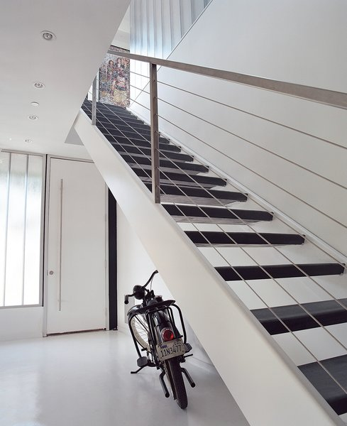 The home's entryway features fly-ash concrete floors and stairs cut from recycled steel.  190+ Best Modern Staircase Ideas from Taking His Own Advice