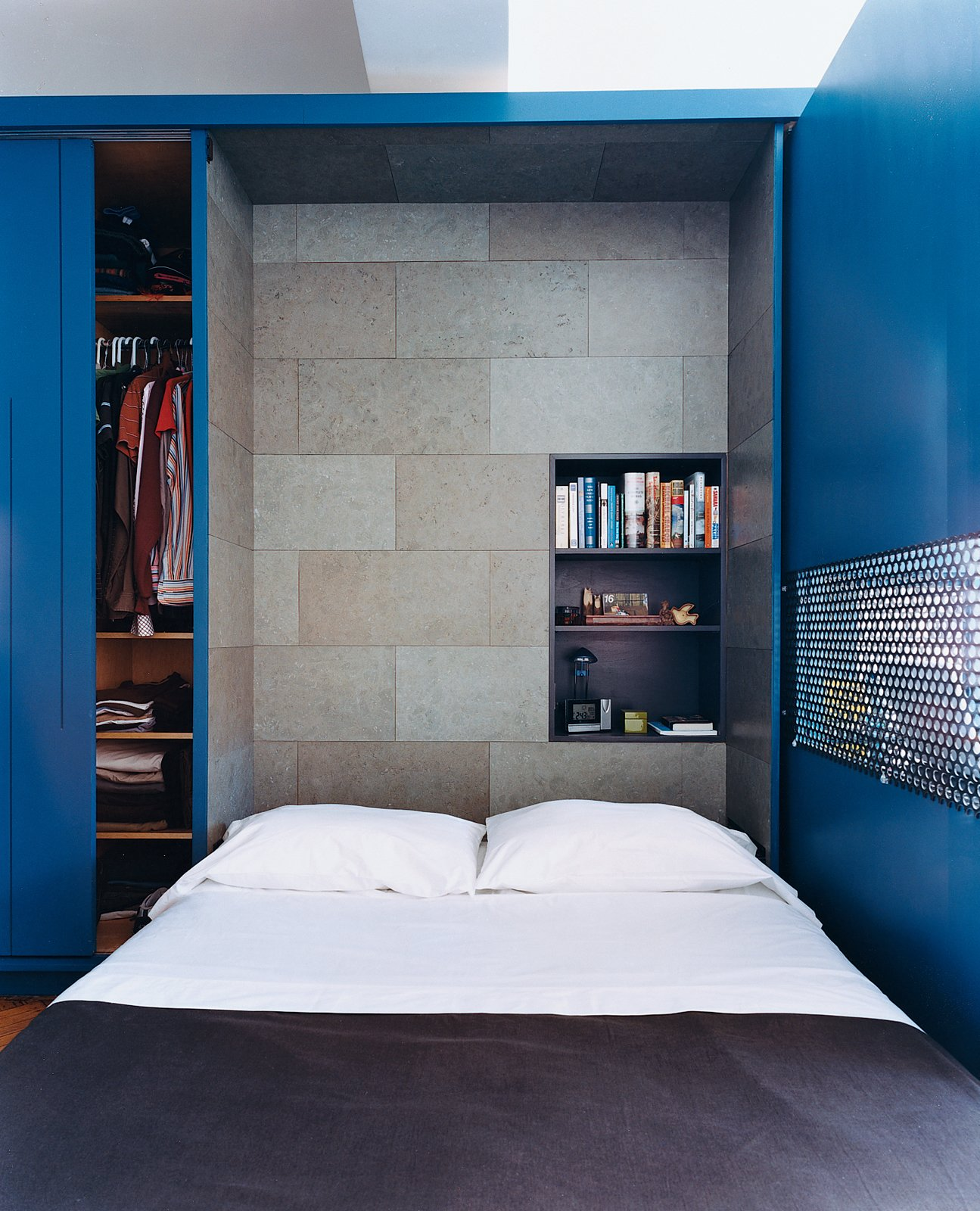 Bedroom The interior of the Murphy bed compartment is lined with a stained cork panel and contains a smaller shelving unit for bedside reading, alarm clock, and reading lamp.  Bedrooms by Dwell