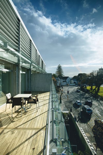 Each apartment features an expansive balcony overlooking the street.