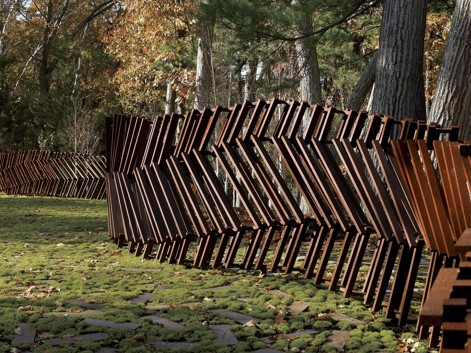 The snaking structure doesn't merely copy the surrounding landscape; instead, it employs a layering of elemental forms found more often in musical compositions.  12 Ways to Get Creative With Cor-Ten Steel by Matthew Keeshin from On the Fence