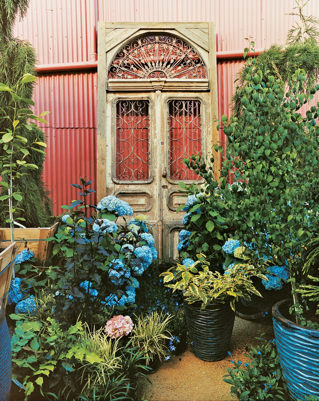 Outdoor and Gardens The intricate retail space is adorned with relics like this ornate door. Corrugated steel panels clad the building's exterior.  Photo 6 of 6 in Fawning Over Flora