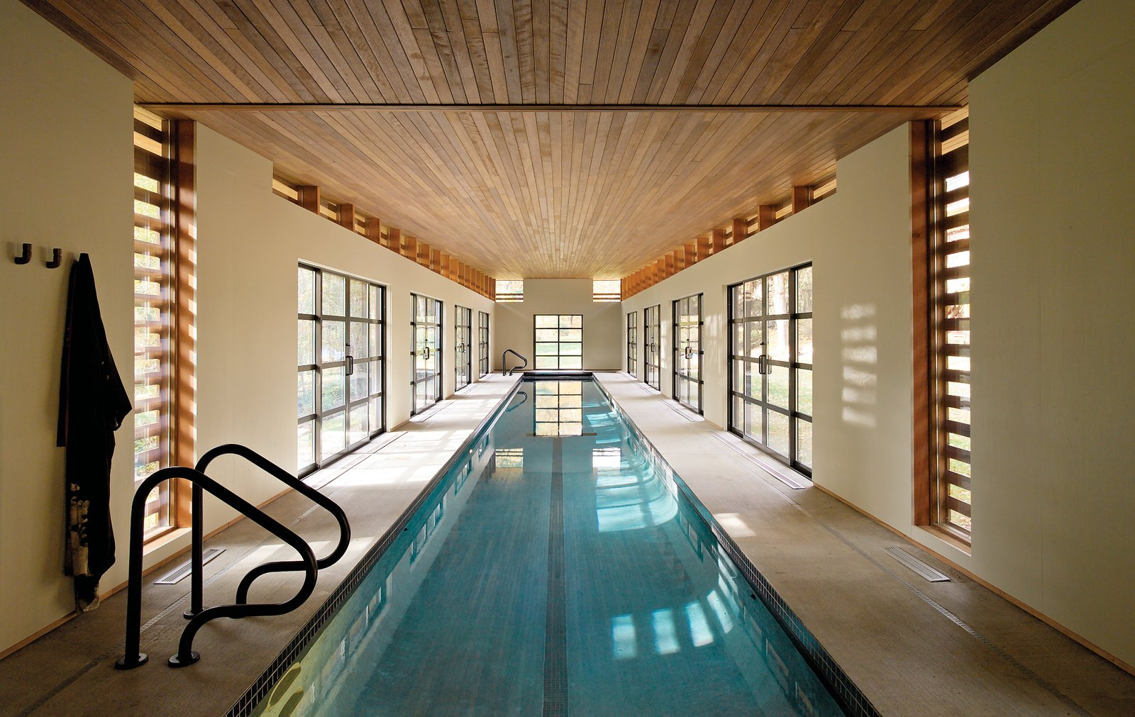 Outdoor, Large Pools, Tubs, Shower, and Swimming Pools, Tubs, Shower Competitive swimmer Sydne Didier commissioned Austin Design Inc. to create a 102-foot-long pool house in a freestanding structure behind her Amherst, Massachusetts, house.  Photo 1 of 3 in Skinny Dip