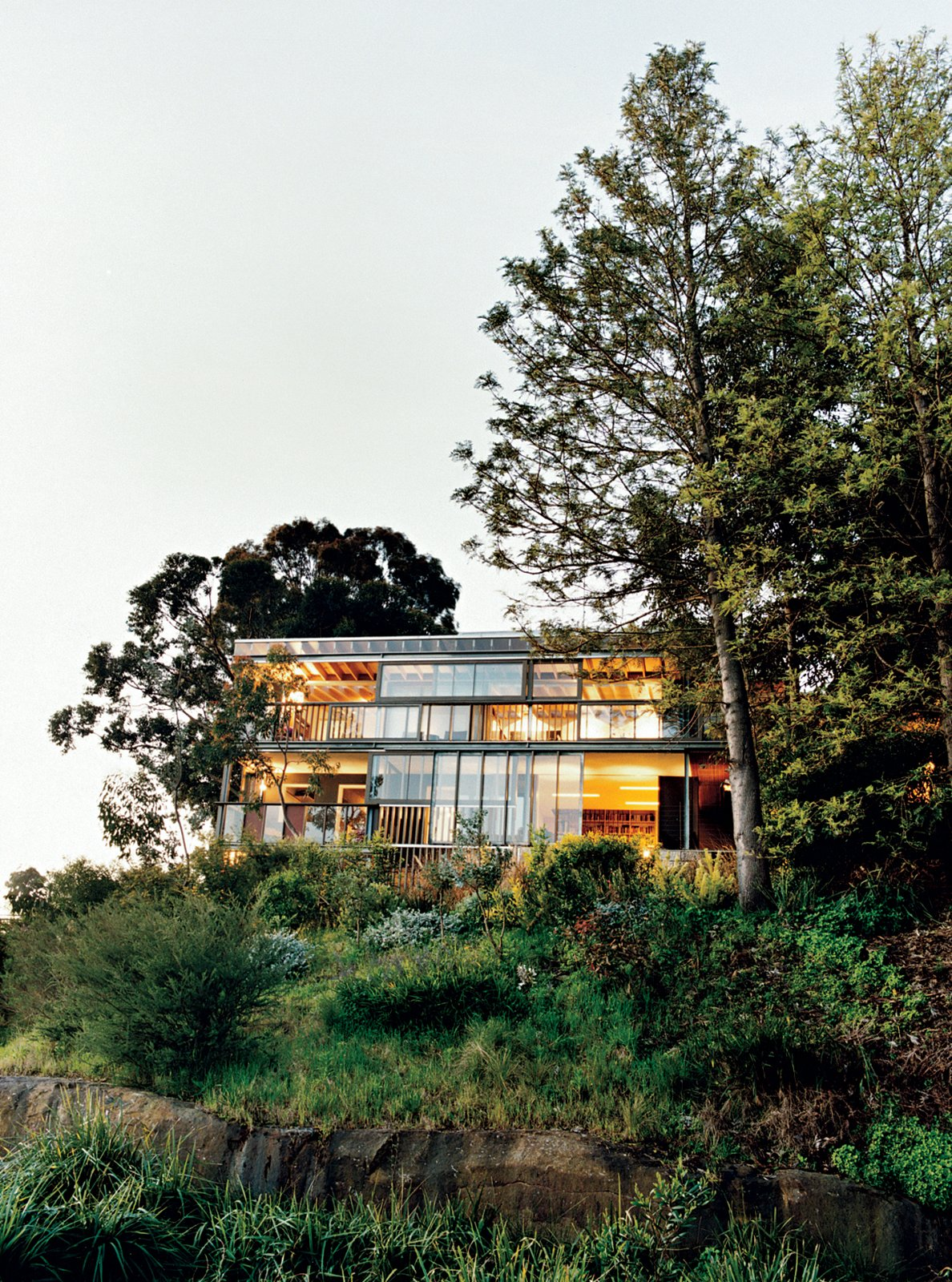 Exterior, Flat RoofLine, Glass Siding Material, and House Building Type The rear facade. A system of sliding glass windows and doors underscore the indoor/outdoor nature of the house.  Photos from A Measured Approach