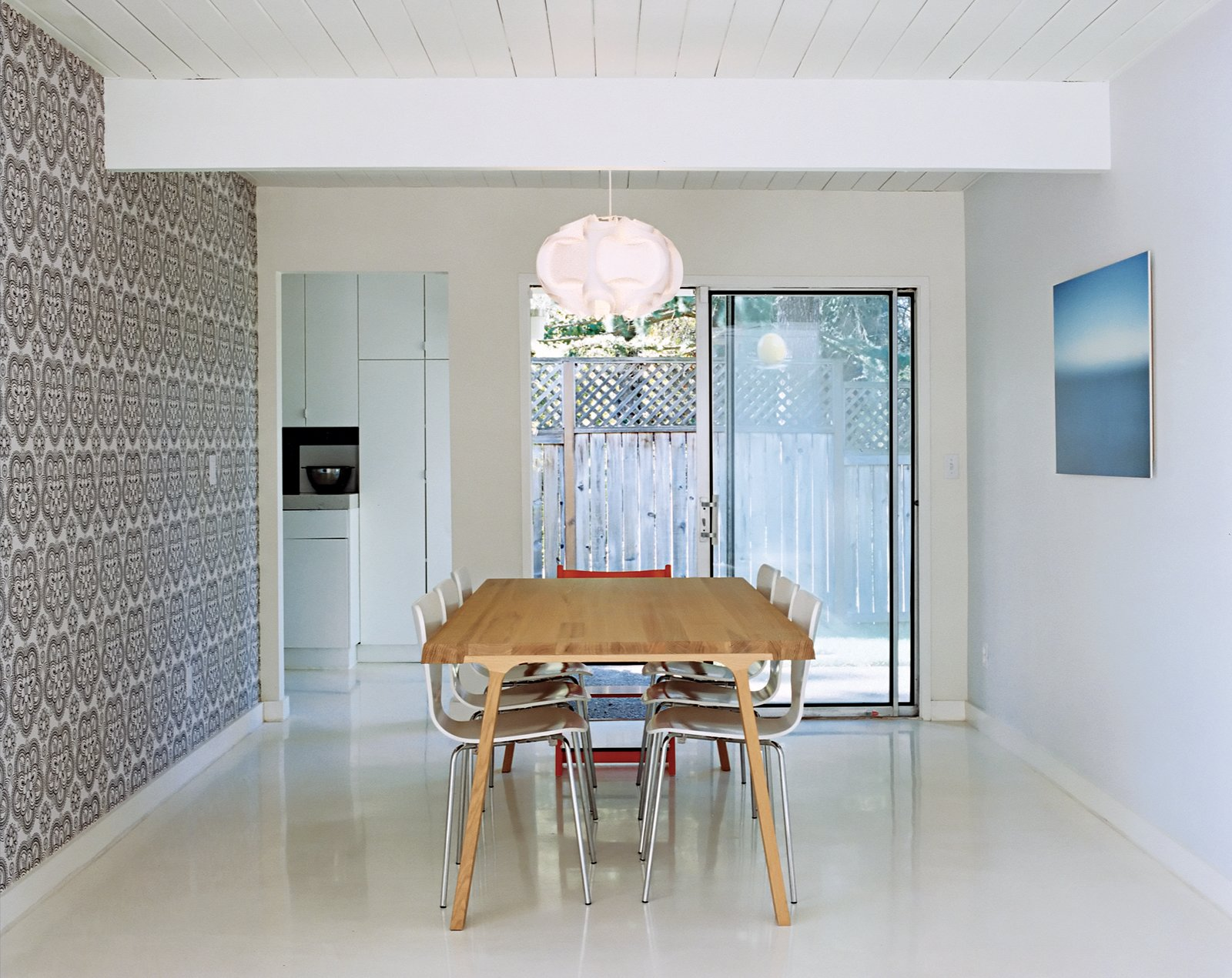 Dining Room, Pendant Lighting, Table, and Chair On those rare sunny days the Segerholts might even forsake their Doble dining table by Montis for their green backyard.  Photos from A Midcentury Modern Home in Southwest Portland
