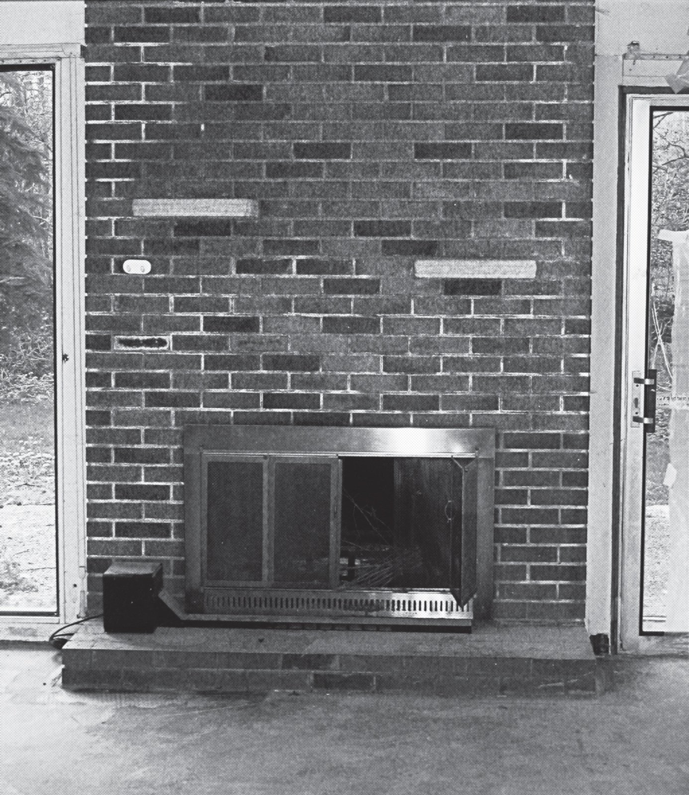"A before shot of  the fireplace. Even though they changed every surface of the place, they ""didn't alter the structure at all,"" Jennifer says.  Photo 6 of 15 in A Mid-Century Modern Home in Southwest Portland"