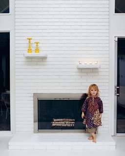Jennifer and Mattias Segerholt renovated a five-bedroom, 2,400-square-foot post-and-beam house in Portland, Oregon. Though the house's features were a complete mess upon purchase, its form was perfectly preserved, including the brick wood-burning fireplace whose chimney rises up the walls to the ceiling.