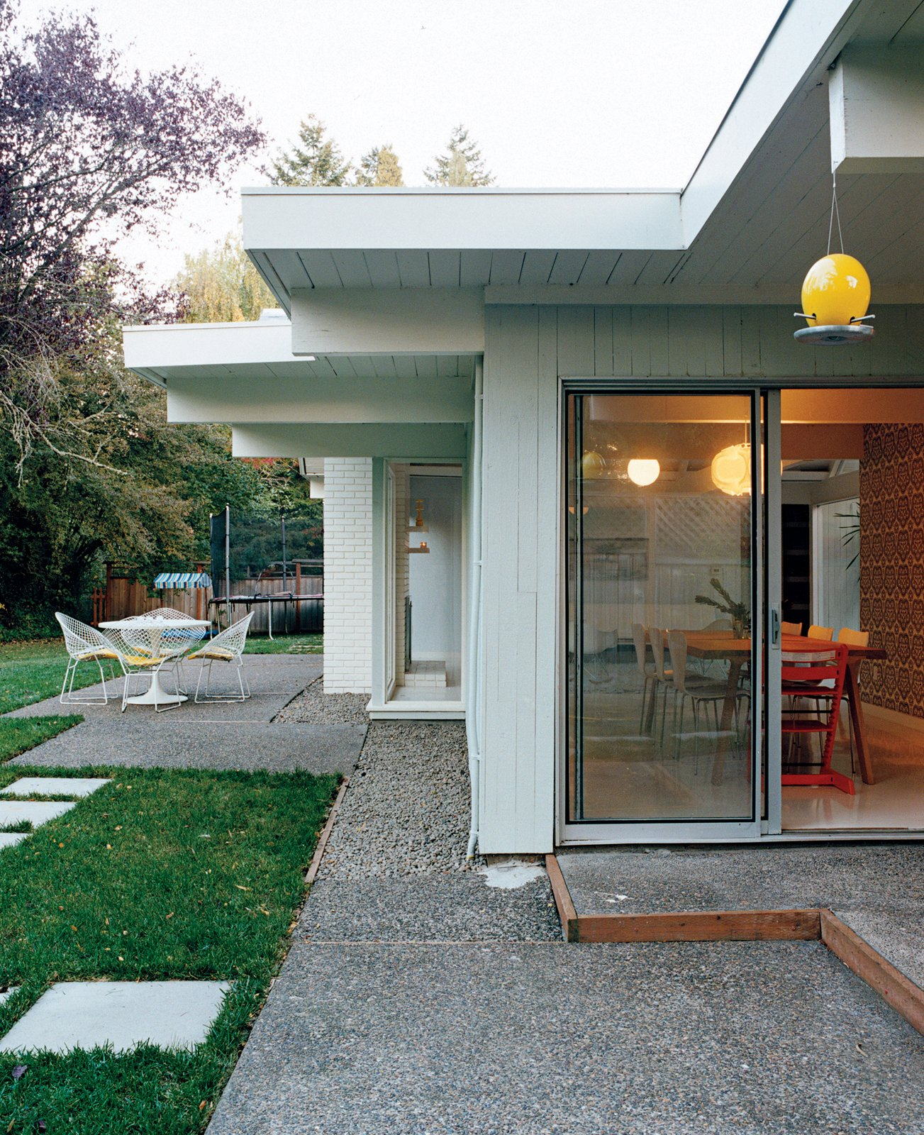 A Dokstra table from Ikea is situated on the patio.  Photo 9 of 15 in A Midcentury Modern Home in Southwest Portland