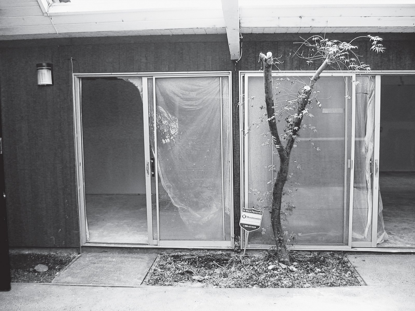 A 2006 photograph shows the dated sliding glass doors.  Photo 13 of 15 in A Mid-Century Modern Home in Southwest Portland
