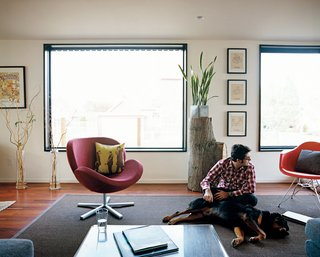 """White says of the living room, """"We just blew it wide open,"""" removing walls to create a bright, continuous space."""