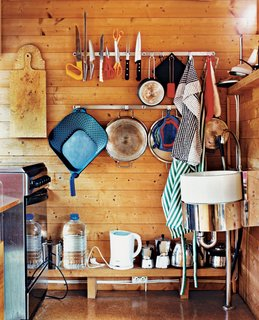 Magnets and hooks keep kitchen necessities within reach.