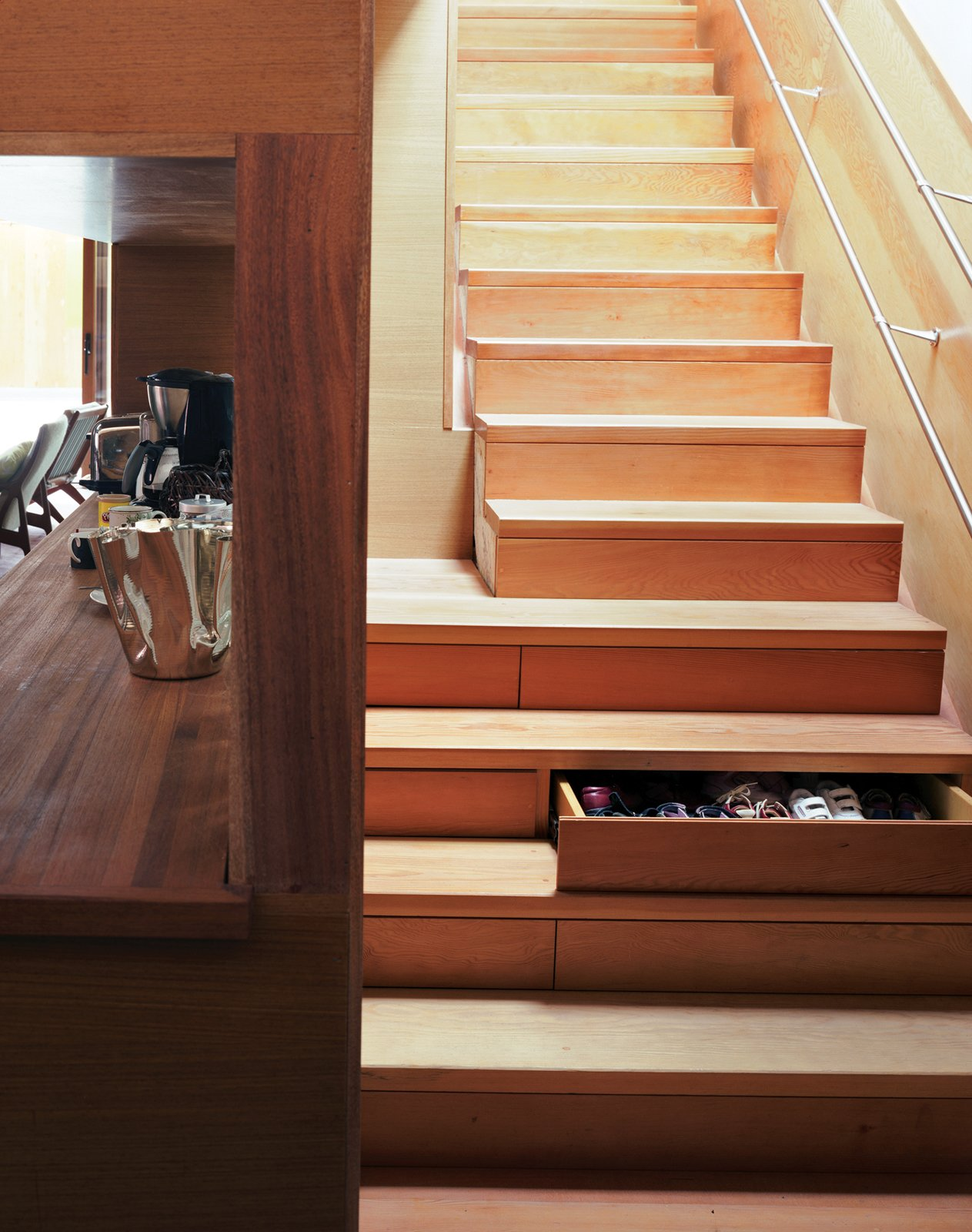 Tan built storage into every available corner of the house, including the stairs, each of which contains a drawer.  Photo 7 of 17 in Inside Job