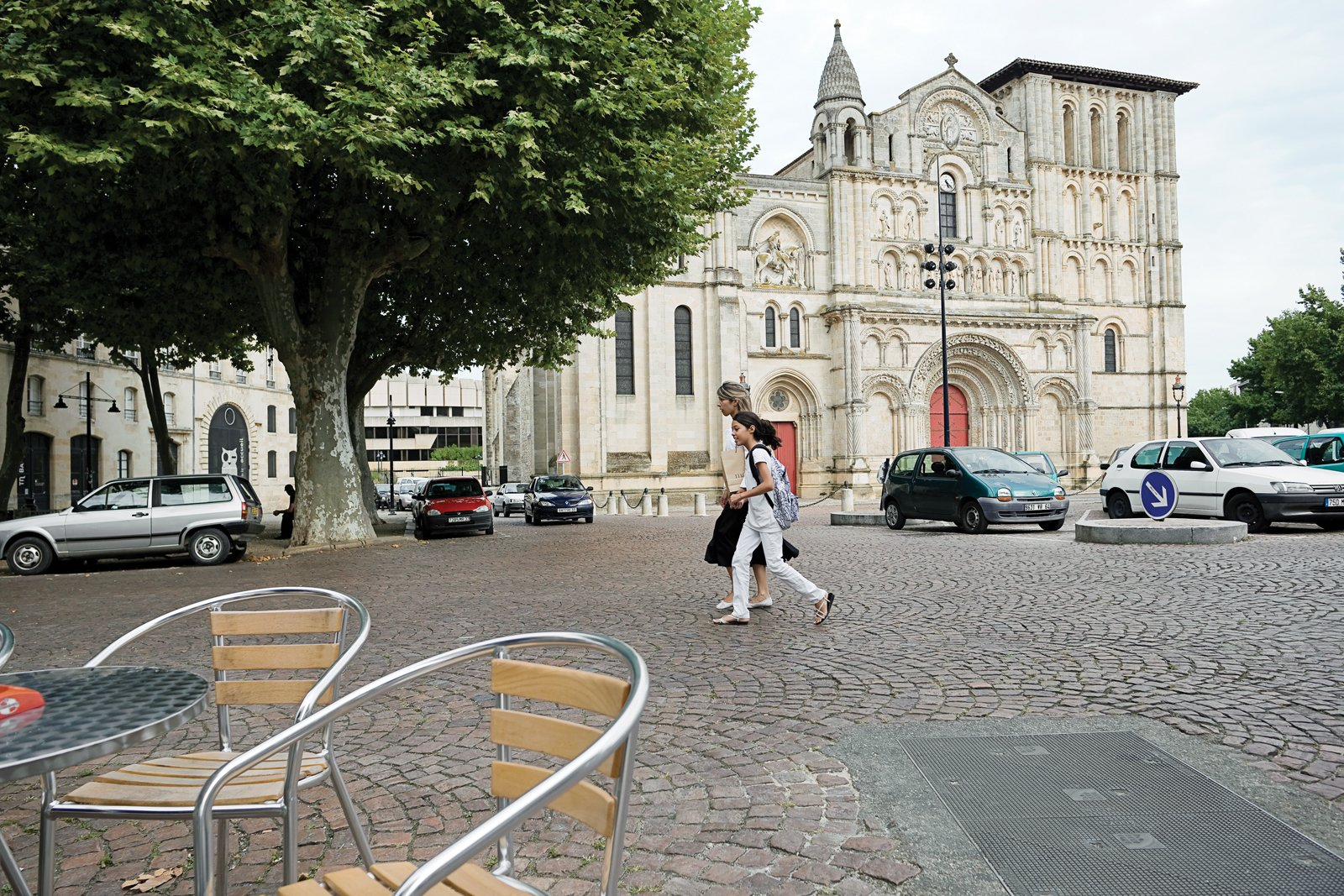 The Romanesque Église Sainte-Croix, constructed during the 12th and 13th centuries, was substantially renovated in the late 19th century, when its southern bell tower was added.  Photo 2 of 9 in Bordeaux, France