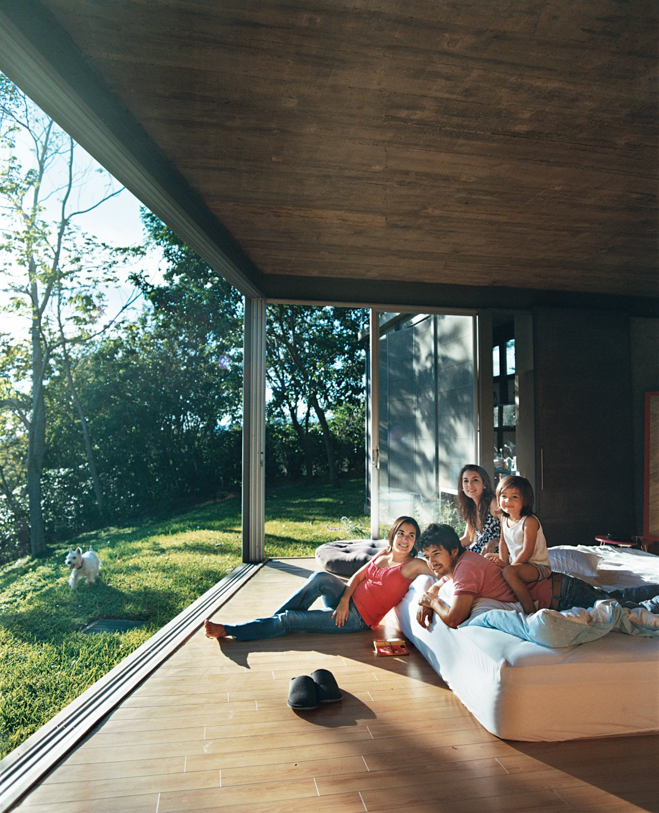 """Bedroom, Bed, and Light Hardwood Floor The bottom level houses the bedrooms where Pilar, José Roberto, Patty, and Jimena loll.  Search """"where pigs fly"""" from Welcome to the Jungle"""
